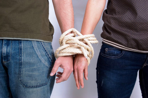 2 people tied at the wrists