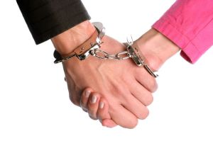 2 people handcuffed holding hands
